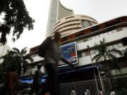 Rupee crosses 55; Sensex up 100 points and Thomas Cook is hot favourite