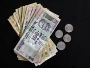 CAD pain: With rupee at 65, it's raining bad news for UPA