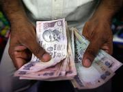 Why NRIs should bet on rupee in 2014