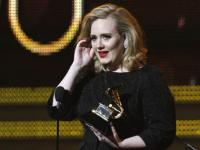 Its Whitney Houstons Grammy  Adele is best solo pop performer