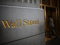 Wall St ends higher after swings on 'fiscal cliff'