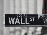 Wall St slips on cliff caution, but homebuilders shine