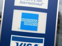Amex to cut 5,400 jobs, take $287 mn restructuring charge