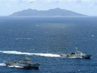 Is China trying to overwhelm Japanese ships on disputed waters?
