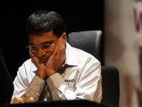Anand crushes Topalov, moves to joint second