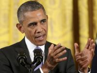 Obama signs 2-year budget deal before default deadline; puts off fight for next year