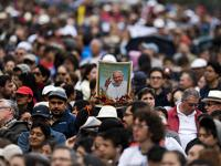 Thousands line the streets of Ecuador for Pope Francis as he begins his South America tour