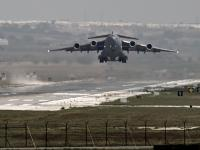 Stung by Paris Attacks, US-led coalition jets pound IS 'capital' in Syria, oil trucks