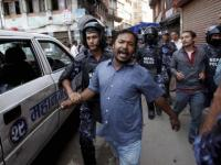 Nepal adopts historic Constitution amid protests