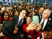 Plane carrying 163 Syrian refugees arrives in Canada, PM Trudeau calls for 'open hearts'