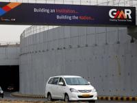 GMR plans to cut its soaring debt, but infra arm faces exhcange ire over fund raising news