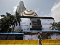 Sensex still in red, but off early lows; sheds nearly 900 pts in 3 sessions