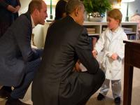 Just another day at the palace: Prince George greets US President Barack Obama in pajamas