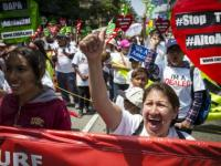 May Day protesters call for better wages and end to deportations