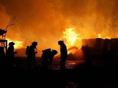 California wildfires kill 21, thousands being evacuated as firefighters face high-speed winds