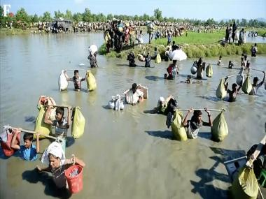 Ten drown as Rohingya boat sinks off Bangladesh, 12,000 more arrive