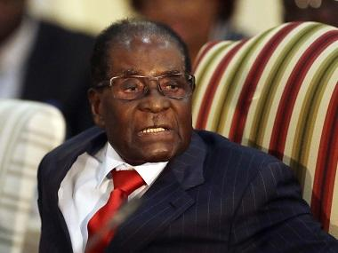 Robert Mugabe's party plans his eviction, says 'there's no going back'; ousted president resists calls to resign