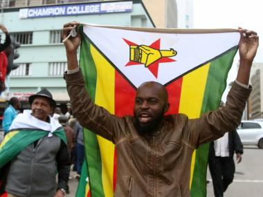 Ecstatic Zimbabweans flood streets of Harare celebrating President Robert Mugabe's downfall