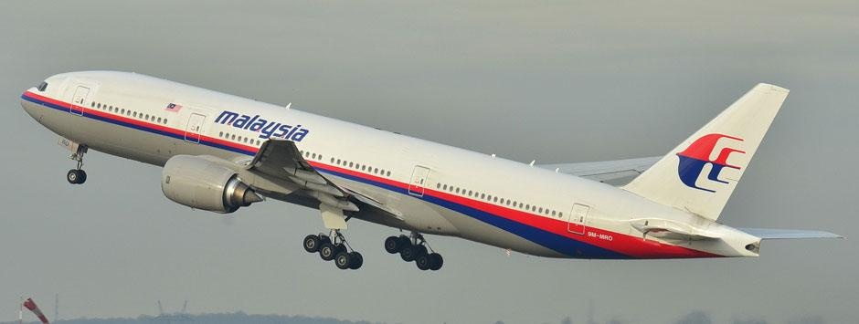 Vietnamese jets find oil slicks in hunt for missing Malaysia plane