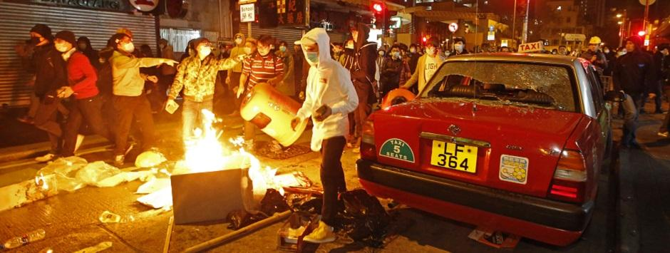 New Year celebrations turn violent: Hong Kong activists, police clash over holiday food stalls