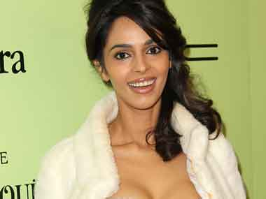 I stopped following Mallika Sherawat  because she re-tweets every compliment or mention of her.Frederick M.Brown/Getty Images