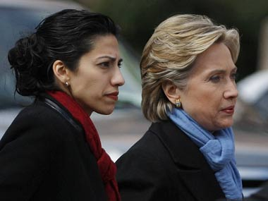 Huma Abedin with Hillary Clinton. Reuters