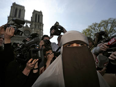 Kenza Drider, a French Muslim of North African descent, wears a niqab outside the Notre Dame Cathedral in Paris April 11, 2011 in this file photo. France banned on full face veils, a first in Europe, exposing anyone who wears the Muslim niqab or burqa in public to fines of 150 euros ($216) and lessons in French citizenship. Gonzalo Fuentes/Reuters.