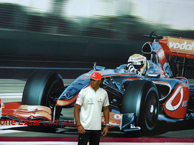 McLaren Formula One driver Hamilton stands in front of picture of race car during promotional event in New Delhi in 2009. Reuters