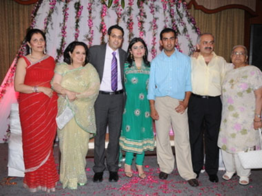 Family photo of the cricket player, married to Natasha Jain , famous for Delhi cricket team & Kolkata Knight Riders.