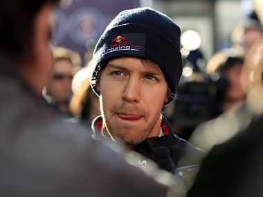 Red Bull Formula One driver Sebastian Vettel of Germany listens a journalist in the paddock in Jerez. Reuters