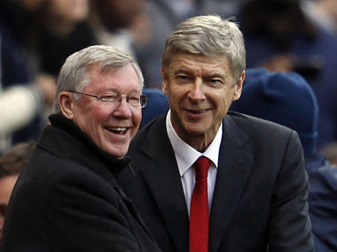 Manchester United's manager Alex Ferguson greets Arsenal's manager Arsene Wenger before their English Premier League soccer match in London. Reuters