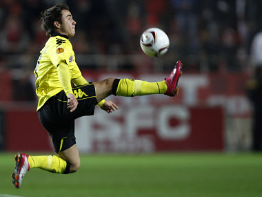 Borussia Dortmund's Mario Gotze jumps for the ball during their soccer match against Sevilla in Seville. Reuters