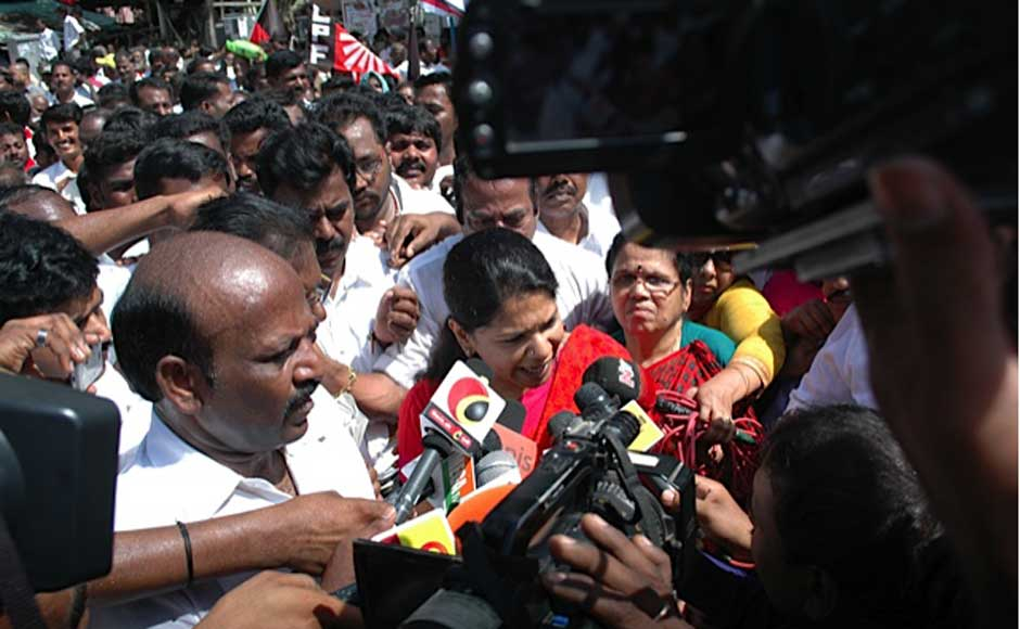 "Kanimozhi courting arrest at Saidapet in the city as part of the DMK's ""Fill the Jail"" agitation. Firstpost"