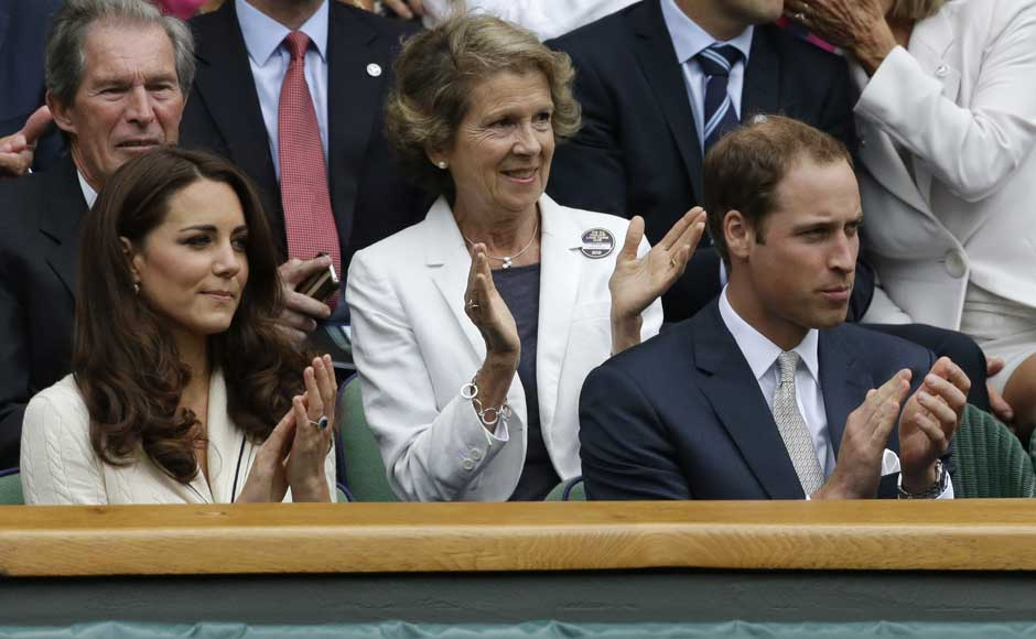Britain's Prince William, right, and his wife Kate, Duchess of Cambridge applaud ahead of a quarterfinals match between Roger Federer of Switzerland and Mikhail Youzhny of Russia. AP