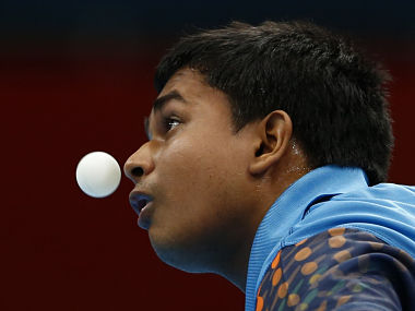 India's Soumyajit Ghosh prepares to serve against Brazil's Gustavo Tsuboi during their men's singles first round table tennis match at the ExCel venue of the London 2012 Olympic Games in London. Reuters
