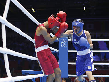 India's Thapa fights against Mexico's Valdez Fierro in their Men's Bantam (56kg) Round of 32 Bout 6 boxing match at ExCeL venue during the London 2012 Olympic Games. Reuters