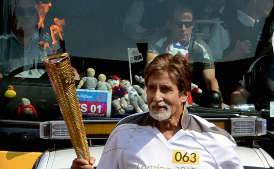 Amitabh Bachchan carries Olympic torch in London. PTI