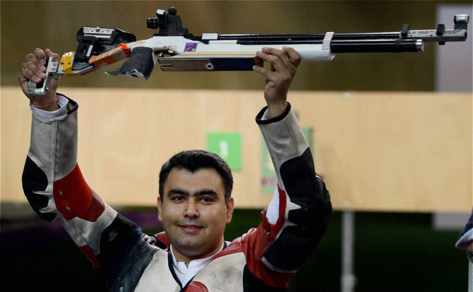 Indian shooter Gagan Narang poses for photographs after winning bronze in 10m air rifle event at the Olympic Games 2012. PTI