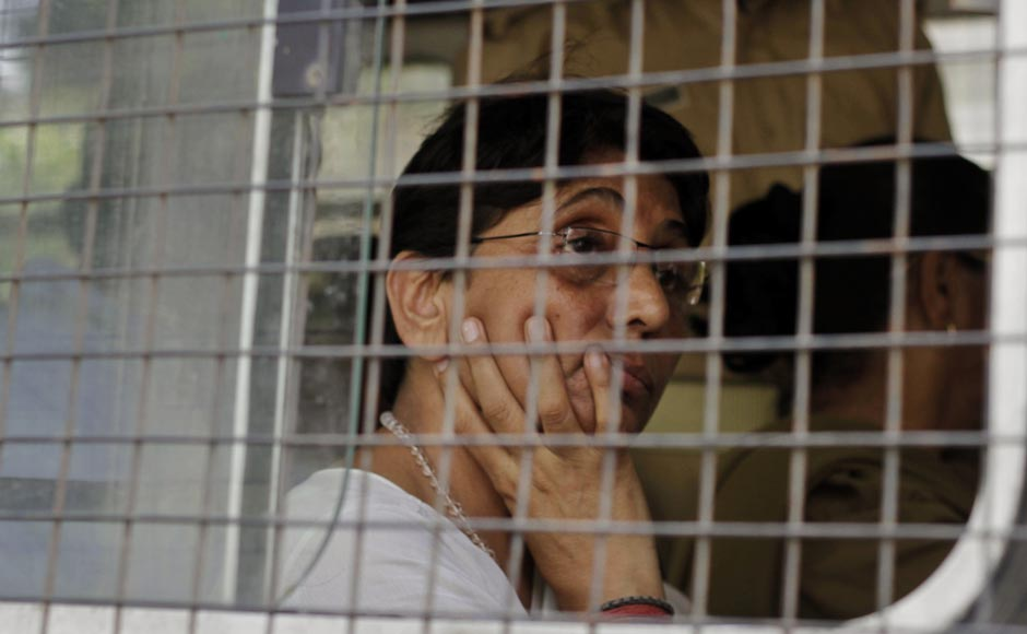 Maya Kodnani, in a police vehicle, arrives at a special court in Ahmedabad, ahead of the sentencing for the 2002 Naroda Patiya massacre.AP