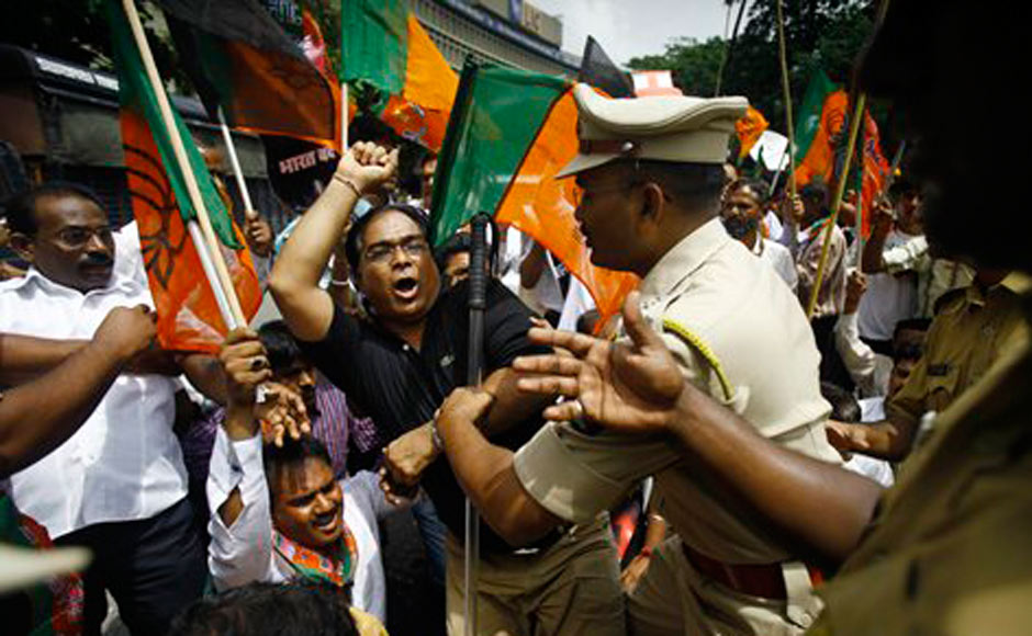 Police detain activists of the Bharatiya Janata Party during a protest in Mumbai. AP