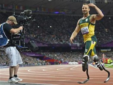 Pistorius of South Africa leaves the track after winning his men's 200m T44 classification heat in a new world record time at the Olympic Stadium during the London 2012 Paralympic Games. Reuters