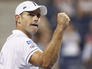 Roddick of the U.S. celebrates a point in the third set against Tomic of Australia at the US Open men's singles tennis tournament in New York. Reuters