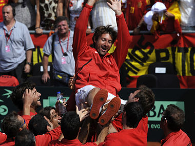 Ferrero of Spain celebrates with his team mates after their victory over the United States on day three of the semi final Davis Cup between Spain and the U.S. at the Parque Hermanos Castro in Gijon. Reuters