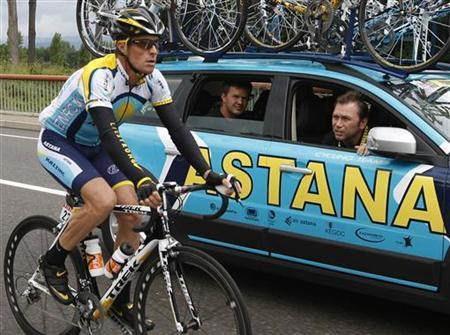 Astana rider Armstrong of the U.S. talks with Astana team manager Bruyneel during the 14th stage of the 96th Tour de France cycling race between Colmar and Besancon. Reuters