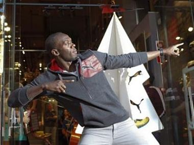 Jamaica's double Olympic champion sprinter Usain Bolt stikes a pose while inaugurating a Puma store in Barcelona. Reuters