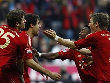 Bayern Munich's Mueller, Martinez, Alaba and Schweinsteiger celebrate goal during German first division Bundesliga soccer match against Hanover 96 in Munich. Reuters