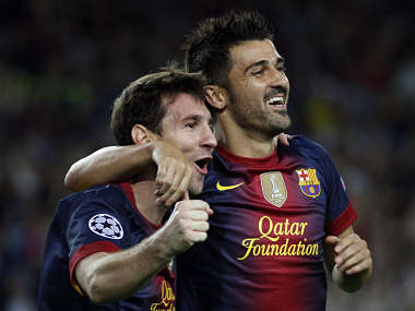 Barcelona's Messi has support from David Villa again. Reuters