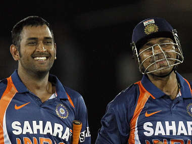 India's Sehwag and captain Dhoni share a joke. Reuters