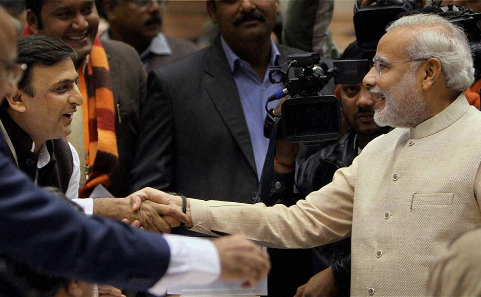 Gujarat Chief Minister Narendra Modi shakes hands with UP Chief Minister Akhilesh Yadav during the 57th National Development Council (NDC) meeting in New Delhi. PTI