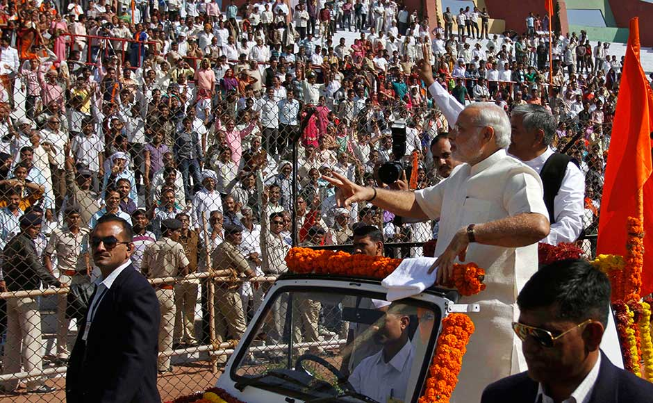 Narendra Modi greets his supporters after the oath taking ceremony as the Gujarat state Chief Minister. Ajit Solanki/ AP